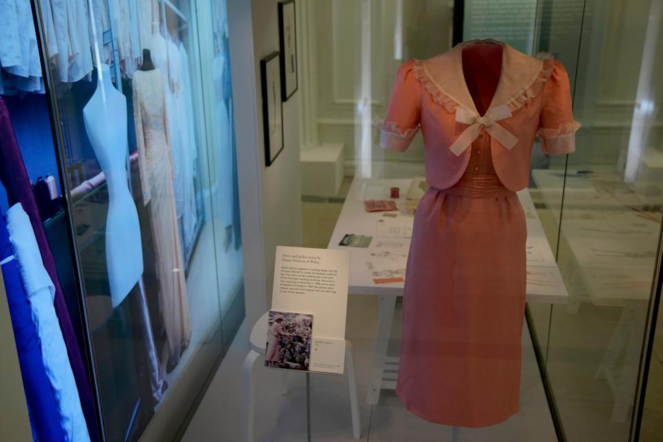 The items have been assembled from the archives of the royal family's couturiers (AP)