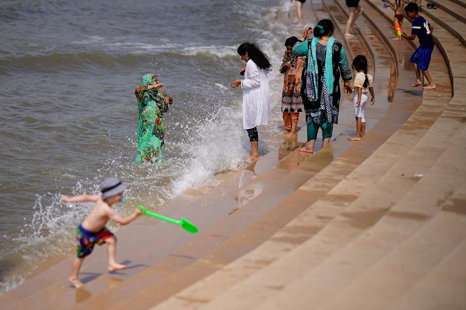 """BLACKPOOL, ENGLAND - JULY 27:  Families relax and cool off in the sea on July 27, 2018 in Blackpool, England. The heatwave continues across the United Kingdom with media outlets describing today as """"Furnace Friday"""" after all time record temperatures were predicted by forecasters. The unusual weather pattern is causing traffic and transport delays and is set to bring storms to eastern areas overnight.  (Photo by Christopher Furlong/Getty Images)"""