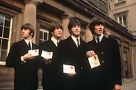 """<p>Even though this wasn't The Beatles' first time meeting the Queen (they performed for her in 1963 and John Lennon famously told her to """"<a href=""""https://www.youtube.com/watch?v=rvBCmY7wAAU"""" rel=""""nofollow noopener"""" target=""""_blank"""" data-ylk=""""slk:just rattle your jewelry"""" class=""""link rapid-noclick-resp"""">just rattle your jewelry</a>"""" while they played """"Twist and Shout""""), this was the most honorable occasion. The Queen awarded the Fab Four The Most Excellent Order of the British Empire (OBE) in 1965 and they sported classic black suits for the event, naturally.</p>"""