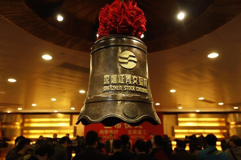 A bell bearing the logo of the Shenzhen Stock Exchange is seen during a companies listing ceremony in Shenzhen