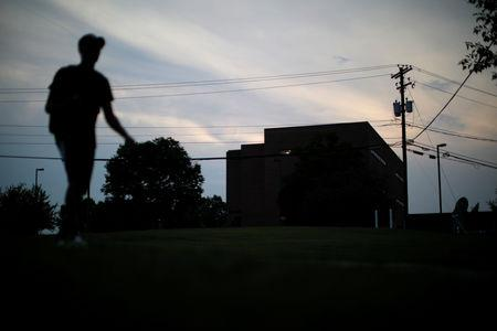 A man walks past the local Roman Catholic Diocese building in Harrisburg, Pennsylvania, U.S.