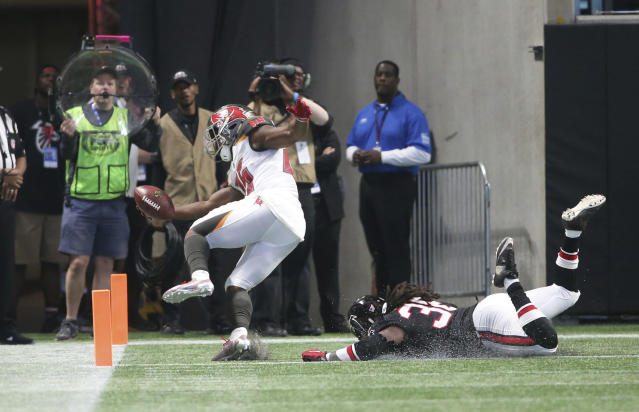 Tampa Bay has finally discovered its ground game. Peyton Barber has emerged as a must-add RB. (AP Photo/John Bazemore)
