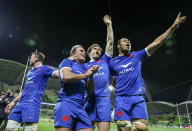 French players celebrate after the second rugby test between France and Australia in Melbourne, Australia, Tuesday, July 13, 2021. France defeated Australia 28-26. (AP Photo/Asanka Brendon Ratnayake)