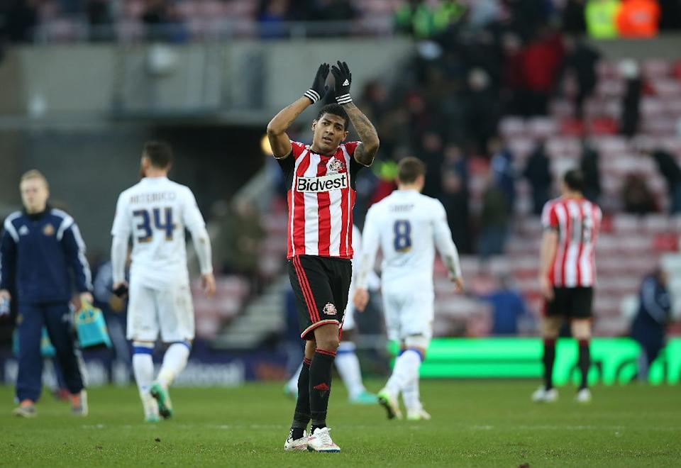 Sunderland's Patrick van Aanholt applauds at the end of the FA Cup third round match against Leeds United in Sunderland on January 4, 2015 (AFP Photo/Ian MacNicol)
