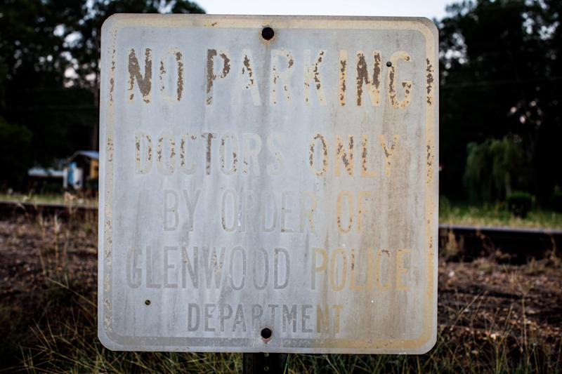 Weathered parking signs posted outside the shuttered Lower Oconee Community Hospital in Glenwood.