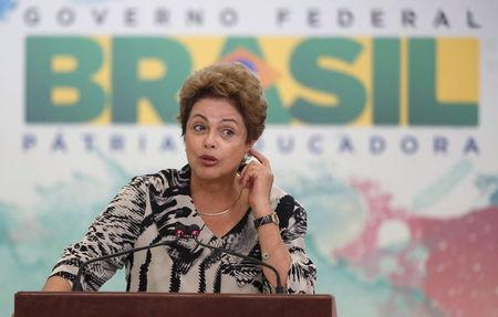 Brazil's President Rousseff gestures during a ceremony at the Planalto Palace in Brasilia
