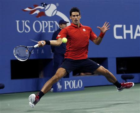 Novak Djokovic of Serbia hits a return to Rafael Nadal of Spain during their men's final match at the U.S. Open tennis championships in New York, September 9, 2013. REUTERS/Eduardo Munoz