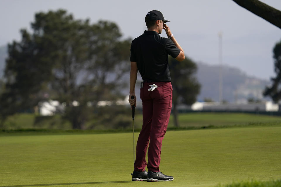 Mackenzie Hughes, of Canada, reacts after missing his putt on the 16th green during the third round of the U.S. Open Golf Championship, Saturday, June 19, 2021, at Torrey Pines Golf Course in San Diego. (AP Photo/Gregory Bull)