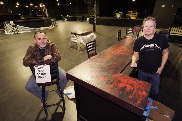 Dave Brown, left, and Mike Grimes, co-owners of The Basement East, pose inside the rebuilt music venue Thursday, Feb. 25, 2021, in Nashville, Tenn. The building was destroyed by a tornado March 3, 2020, and the difficulties of reopening were compounded by COVID-19. Now, as the anniversary of the two catastrophic events approaches, the owners hope to reopen their doors, this time with masks and tables spread out throughout their 5,000 square foot space. Amid signs that the virus is slowing its spread and more people are getting vaccines, they've set their sights on spring. (AP Photo/Mark Humphrey)