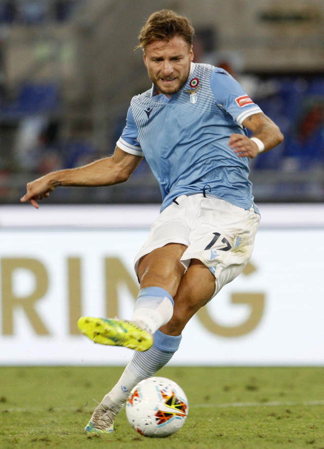 Lazio's Ciro Immobile shoots to score his sides second goal during the Serie A soccer match between Lazio and Brescia, at Rome's Olympic Stadium, Wednesday, July 29, 2020. (AP Photo/Riccardo De Luca)