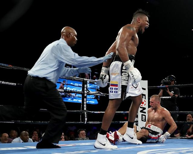 Eleider Alvarez celebrates on the way to a knockout victory over Sergey Kovalev for the WBO light heavyweight world title (AFP Photo/ELSA)