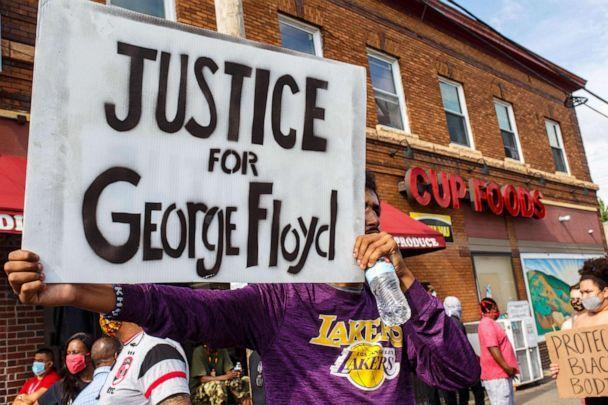 PHOTO: A man holds a sign while protesting near the area where a Minneapolis Police Department officer allegedly killed George Floyd, on May 26, 2020 in Minneapolis, Minnesota. (Kerem Yucel/AFP via Getty Images, FILE)