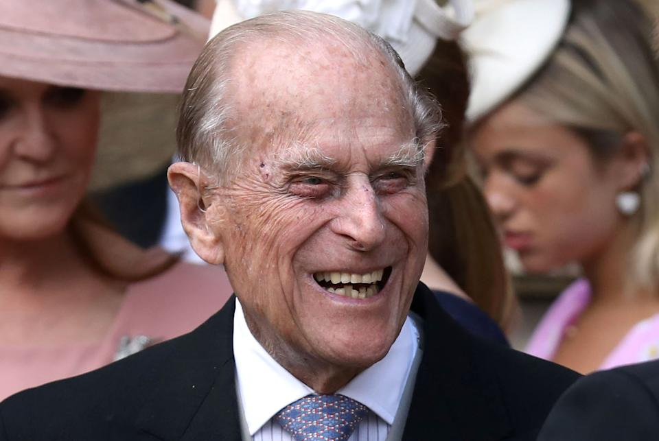Britain's Prince Philip, Duke of Edinburgh reacts as he talks with Britain's Prince Harry, Duke of Sussex as they leave St George's Chapel in Windsor Castle, Windsor, west of London, on May 18, 2019, after the wedding of Lady Gabriella Windsor and Thomas Kingston.
