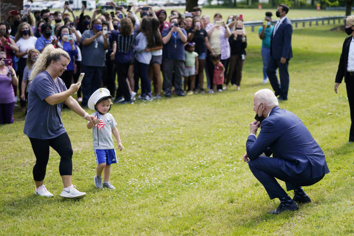President Joe Biden stops outside at York High School and is greeted by a child and his mother, Monday, May 3, 2021, in Yorktown, Va. (AP Photo/Evan Vucci)