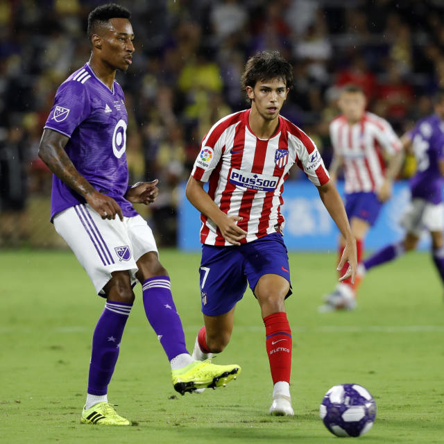 Mark-Anthony Kaye (left), shown here playing for the MLS All-Stars against Joao Felix and Atletico Madrid, has been a revelation for LAFC this season. (Getty)