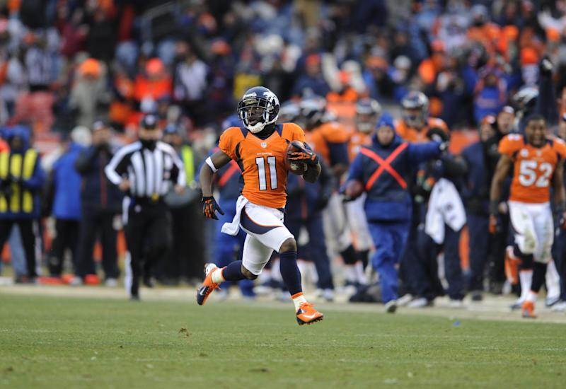 FILE - In this Jan. 12, 2013 file photo, Denver Broncos wide receiver Trindon Holliday runs the opening kickoff of the second half back for a touchdown against the Baltimore Ravens during an AFC divisional playoff NFL football game, in Denver. Holliday piled up an NFL-record 248 yards in returns against the Baltimore Ravens in January. (AP Photo/Jack Dempsey, File)
