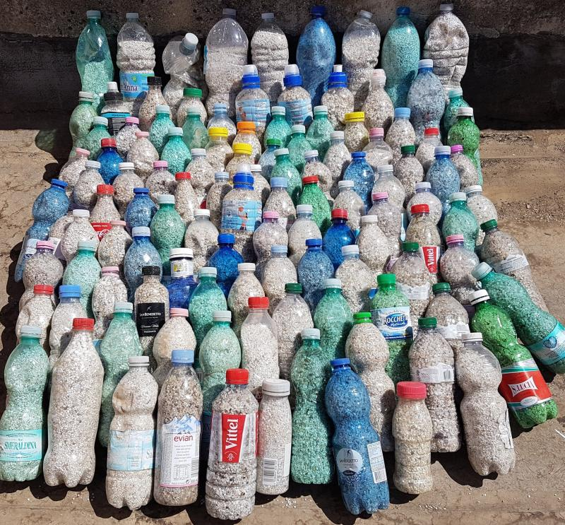 The bottles of 90kg of stolen sand from Sardinia seized by Italian authorities.