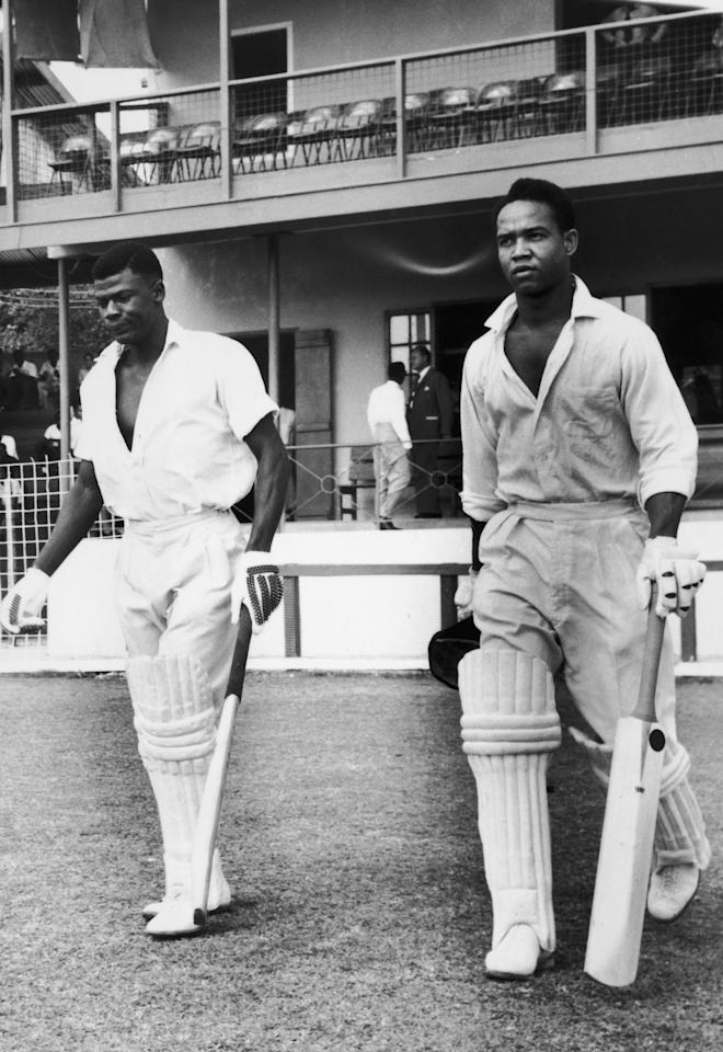 West Indian cricketers Seymour Nurse (left) and Gary Sobers are associated in a third wicket partnership of 306 runs for Barbados against the MCC at Kensington Oval, Barbados, circa 1965. Sobers scored 154 and Nurse 213. (Photo by Hulton Archive/Getty Images)