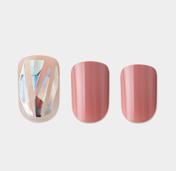 """<p><strong>imPress </strong></p><p>impressmanicure.com</p><p><strong>$7.99</strong></p><p><a href=""""https://www.impressmanicure.com/impress-gel-color-lilac-pink-and-rose-gold-glitter-stripe-accents-harlem-shake"""" rel=""""nofollow noopener"""" target=""""_blank"""" data-ylk=""""slk:Shop Now"""" class=""""link rapid-noclick-resp"""">Shop Now</a></p><p>Edwards lists rosy tan as one of her favorite nail shades. """"Warm nudes are a game-changer because nudes are no longer soft, elusive colors,"""" she says. """"Nudes are now bold, with deep ranges from a pinkish retro nude to a beige brick red."""" She picks these press-on nails as a great option for those with dark skin.</p>"""