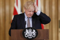 FILE - In this Tuesday, March 3, 2020 file photo Britain's Prime Minister Boris Johnson reacts during a press conference at Downing Street on the government's coronavirus action plan in London. More than 100,000 people have died in the United Kingdom after contracting the coronavirus. That's according to government figures released Tuesday Jan. 26, 2021. Britain is the fifth country in the world to pass that mark, after the United States, Brazil, India and Mexico, and by far the smallest. The U.S. has recorded more than 400,000 COVID-19 deaths, the world's highest total, but its population of about 330 million is about five times Britain's. (AP Photo/Frank Augstein, File)