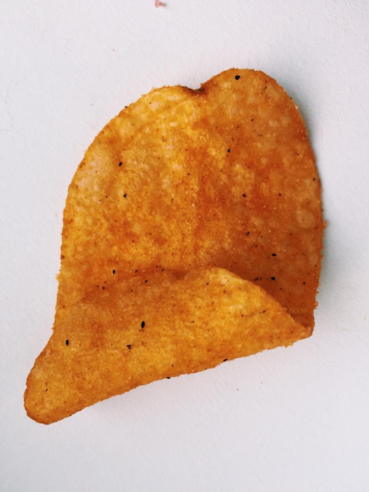 """<p><b>Smell: </b>A rich, flavorful scent that""""smells like Chinese food.""""<b>Taste:</b>As a lover of spicy Asian-influenced flavors, this one was hands down my favorite of the bunch. (I had to stop myself from hoarding it from the other editors.) This was the spiciest chip we tasted and took on the funky essence of Korean pepper pastes, like gochujang. Since exotic flavors will be <a href=""""https://www.yahoo.com/food/16-food-trends-that-will-take-2016-by-storm-132003882.html"""">a big trend this year</a>, we think they're definitely onto something with this one.<b>Our Flavor Prediction:</b> New — Gochujang</p>"""