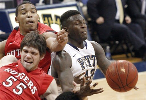 Rutgers' Derrick Randall, left, and Gilvydas Biruta, bottom, compete with Pittsburgh's Talib Zanna for a rebound in the second half of an NCAA college basketball game Wednesday, Jan. 11, 2012, in Pittsburgh. (AP Photo/Keith Srakocic)
