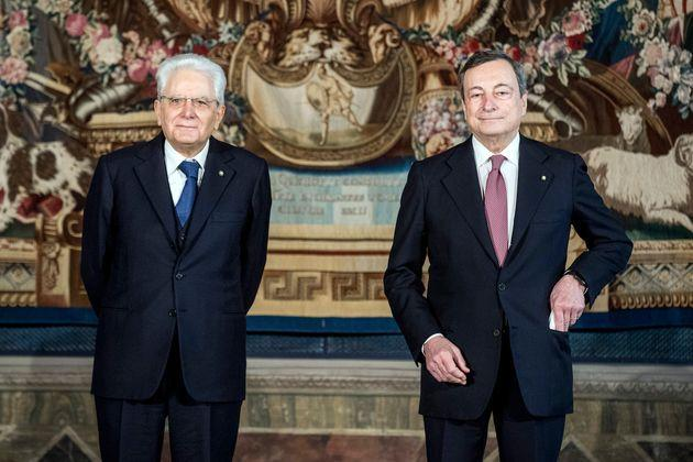 ROME, ITALY - FEBRUARY 13: Italian President Sergio Mattarella(C) and Italian Prime Minister Mario Draghi pose for a picture after the swearing-in ceremony at the Quirinal palace, on February 13, 2021 in Rome, Italy. Former President of the European Central Bank Mario Draghi was sworn in as Italy's Prime Minister today, after the collapse of the Italian government last month. (Photo by Roberto Monaldo/AM POOL/Getty Images) (Photo: AM POOL via Getty Images)