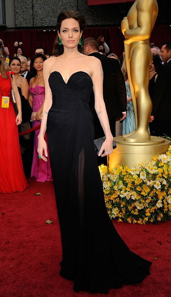 """11. 81st Annual Academy Awards (2009)   The Oscar winner -- who was nominated for a second Academy Award for her work in 2008's """"Changeling"""" -- was the epitome of elegance as she strutted down the red carpet in a sensationally sophisticated Elie Saab gown and emerald statement earrings, courtesy of Lorraine Schwartz."""