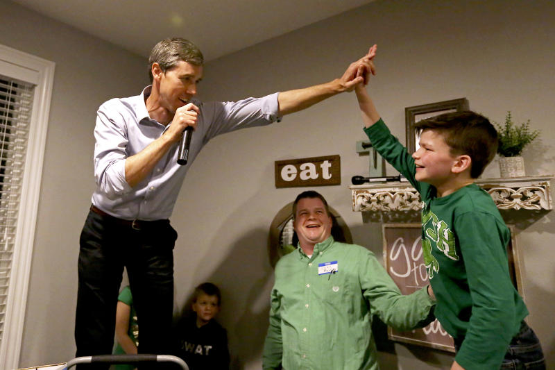 Democratic presidential candidate Beto O'Rourke high-fives Mitchell Murphy, 12, while he speaks at an event at the home of Dubuque County Recorder John Murphy in Dubuque, Iowa on Saturday, March 16, 2019. (Eileen Meslar/Telegraph Herald via AP)