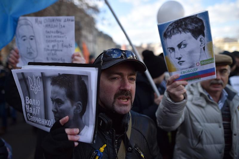 Russian opposition supporters carry placards depicting Nadiya Savchenko during a rally in Moscow, on February 27, 2016 (AFP Photo/Kirill Kudryavtsev)