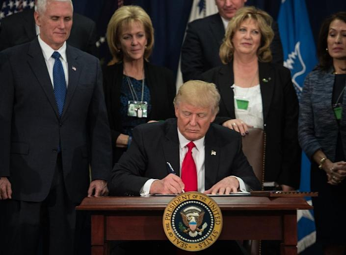 """US President Donald Trump ordered work to begin on planning and building a wall on the Mexican border, saying """"a nation without borders is not a nation"""" (AFP Photo/NICHOLAS KAMM)"""