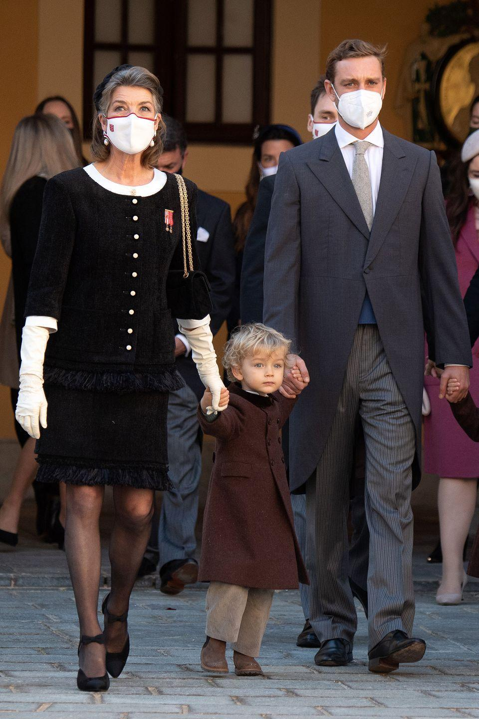 <p>Princess Caroline at the Monaco National Day celebrations in November 2020 with son Pierre Casiraghi and grandson Francesco.</p>