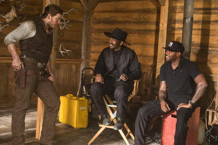 "In this image released by MGM/Columbia Pictures, actors Chris Pratt, left, and Denzel Washington, center, appear on the set with director Antoine Fuqua during the filming of ""The Magnificent Seven."" The film will have its world premiere as the opening film of the 41st Toronto International Film Festival. (Sam Emerson/MGM/Columbia Pictures via AP)"