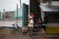 Residents observe the sea as Storm Iota approaches, in Cedeno