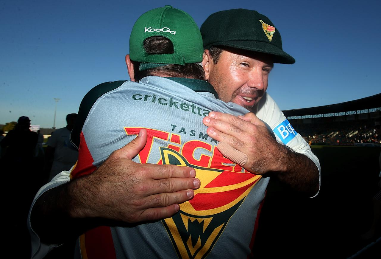 HOBART, AUSTRALIA - MARCH 26:  Ricky Ponting of the Tigers embraces coach Tim Coyle after victory in the Sheffield Shield final between the Tasmania Tigers and the Queensland Bulls at Blundstone Arena on March 26, 2013 in Hobart, Australia.  (Photo by Mark Metcalfe/Getty Images)