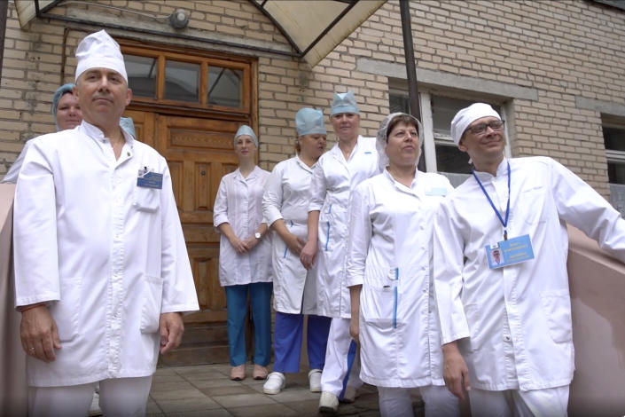 In this photo made from footage provided by the Russian Defense Ministry on Wednesday, July 15, 2020, medical workers look at volunteers participating in a trial of a coronavirus vaccine as they leave the Budenko Main Military Hospital outside Moscow, Russia. Russia is boasting that it's about to be the first country to approve a COVID-19 vaccine, but scientists worldwide are sounding the alarm that the headlong rush could backfire. (Russian Defense Ministry Press Service via AP)