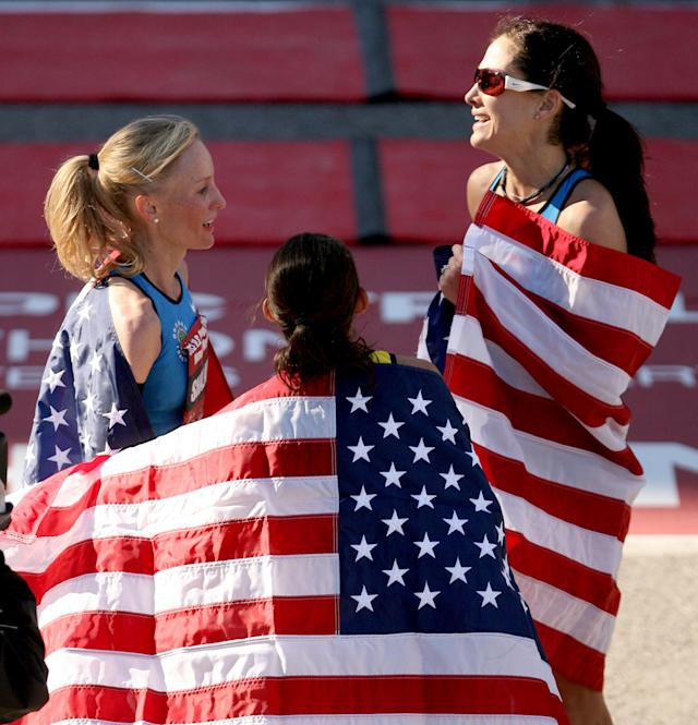 HOUSTON, TX - JANUARY 14: (L-R) Desiree Davila, Shalane Flanagan, and Kara Goucher celebrate with American flags after the U.S. Marathon Olympic Trials January 14, 2012 in Houston, Texas. (Photo by Thomas B. Shea/Getty Images)