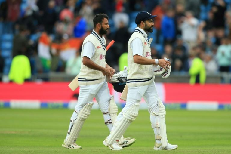 Unbroken stand - India captain Virat Kohli (R) and Cheteshwar Pujara (L) walk off at stumps on the third day of the third Test against England at Headingley on Friday (AFP/Lindsey Parnaby)