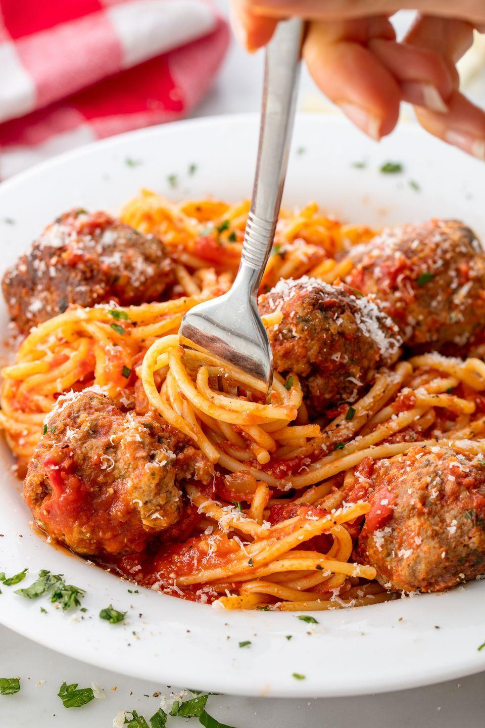 """<p>Making your own meatballs and sauce makes it even better.</p><p>Get the recipe from <a href=""""https://www.delish.com/cooking/recipe-ideas/recipes/a55764/best-spaghetti-and-meatballs-recipe/"""" rel=""""nofollow noopener"""" target=""""_blank"""" data-ylk=""""slk:Delish"""" class=""""link rapid-noclick-resp"""">Delish</a>.</p><p><a class=""""link rapid-noclick-resp"""" href=""""https://www.amazon.com/dp/1328498867/?tag=syn-yahoo-20&ascsubtag=%5Bartid%7C1782.g.3338%5Bsrc%7Cyahoo-us"""" rel=""""nofollow noopener"""" target=""""_blank"""" data-ylk=""""slk:GET YOURS NOW!"""">GET YOURS NOW!</a> <strong><em>Delish Cookbook, amazon.com</em></strong><br></p>"""