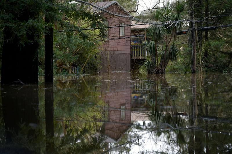 A home is seen reflected in the flood waters of the Russian River in Forestville, Calif., on Feb. 27, 2019. (Photo: Michael Short/AP)