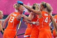 Netherlands' Caia van Maasakker (L) celebrates with her team mate Kitty van Male after scoring a goal against Belgium during their women's Group A hockey match at the London 2012 Olympic Games at the Riverbank Arena on the Olympic Park in London July 29, 2012. REUTERS/Suzanne Plunkett