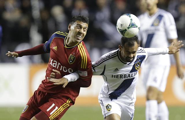 Real Salt Lake's Javier Morales (11) battles with Los Angeles Galaxy's Juninho for a header in the first half during the second leg of the MLS Western Conference semifinal soccer game, Thursday, Nov. 7, 2013, in Sandy, Utah. (AP Photo/Rick Bowmer)