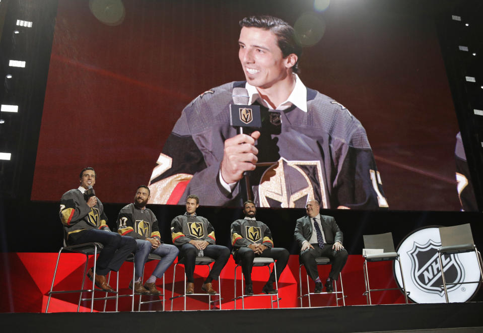 FILE - In this June 21, 2017, file photo, from left, Vegas Golden Knights' Marc-Andre Fleury, Deryk Engelland, Brayden McNabb and Jason Garrison sit on stage during an event following the NHL expansion draft in Las Vegas. In 2017, the NHL altered some of its expansion draft rules and Vegas used the expansion draft to become the most successful first-year franchise in league history, reaching the Stanley Cup Final. It is same rules and situation this time around for the Seattle Kraken, which have its own expansion draft next week. (AP Photo/John Locher, File)