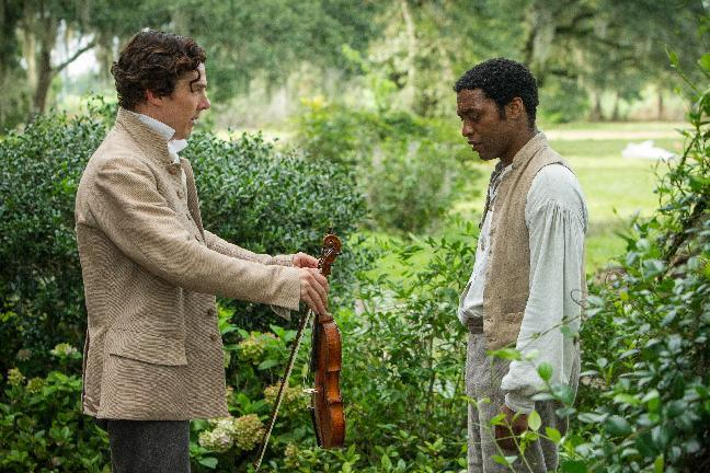 "This image released by Fox Searchlight shows Benedict Cumberbatch, left, and Chiwetel Ejiofor in a scene from ""12 Years A Slave."" From ""12 Years a Slave"" to ""The Butler"" to ""Fruitvale Station,"" 2013 has been a banner year for movies directed by black filmmakers. Like seldom before, African American stories are being told on the big screen without white protagonists. (AP Photo/Fox Searchlight, Jaap Buitendijk)"