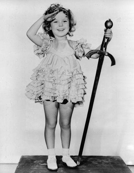 """FILE - In this 1933 file photo, child actress Shirley Temple is seen in her role as """"Little Miss Marker"""". Shirley Temple, the curly-haired child star who put smiles on the faces of Depression-era moviegoers, has died. She was 85. (AP Photo/File)"""