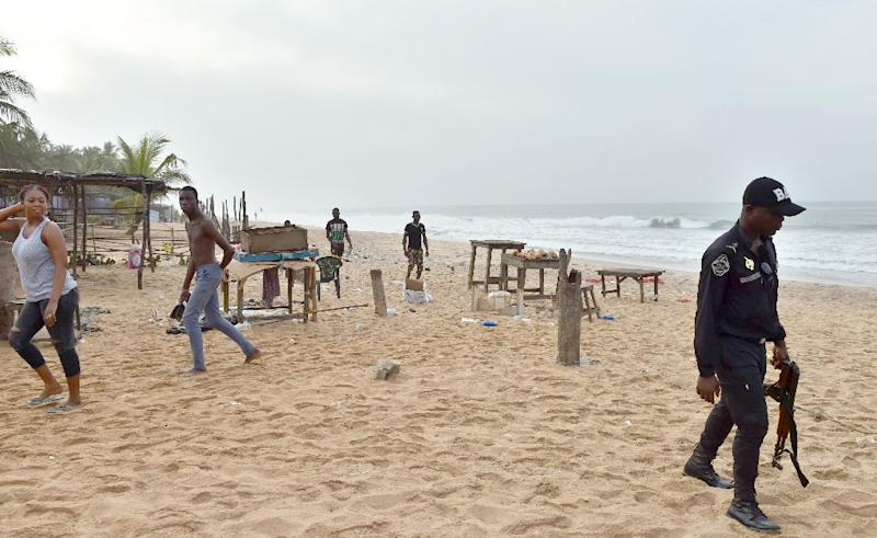 An Ivorian patrols along the beach in Grand Bassam, some 40 kms east of Abidjan on March 14 , 2016, a day after gunmen attacked the Ivory Coast resort town (AFP Photo/Issouf Sanogo)