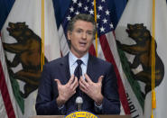 FILE - In this Jan. 8, 2021, file photo, California Gov. Gavin Newsom outlines his 2021-2022 state budget proposal during a news conference in Sacramento, Calif. Law enforcement officials are investigating escalating threats of death and violence against California Gov. Gavin Newsom, his family and the the wineries, shops and other businesses he founded. (AP Photo/Rich Pedroncelli, Pool, File)