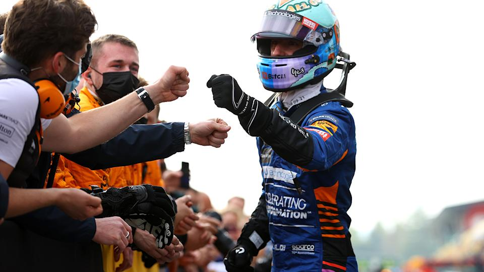 Sixth placed Daniel Ricciardo celebrates in parc ferme with McLaren team members after the F1 Grand Prix of Emilia Romagna. (Photo by Bryn Lennon/Getty Images)