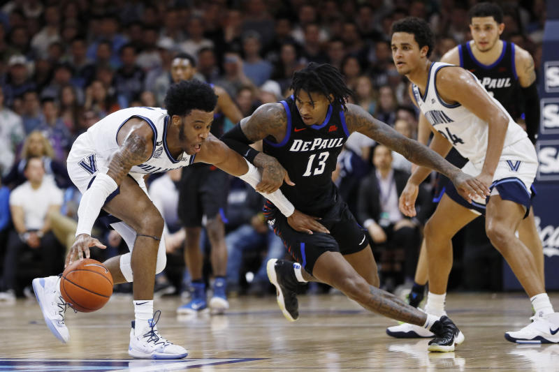 Villanova's Saddiq Bey, left, tries to dribble past DePaul's Darious Hall during the first half of an NCAA college basketball game, Tuesday, Jan. 14, 2020, in Villanova, Pa. (AP Photo/Matt Slocum)