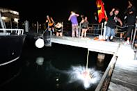 <p>The head of the statue of Egerton Ryerson is brought to Toronto Harbour. Protesters threw the head into the harbour to cleanse it and then relieved it to preserve it for Land Back. (Steve Russell/Toronto Star via Getty Images)</p>